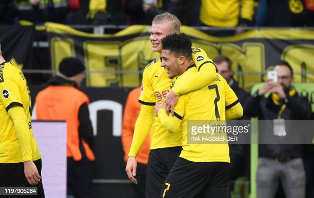 Dortmund's English forward Jadon Sancho and Dortmund's Norwegian forward Erling Braut Haaland celebrate a goal during the German first division...