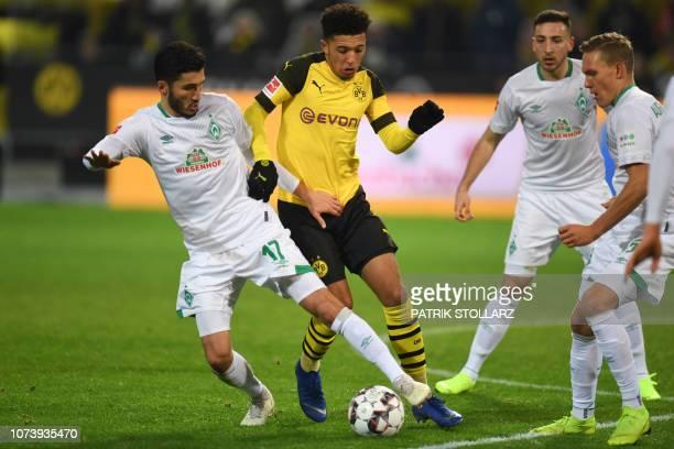 Dortmund's English midfielder Jadon Sancho and Bremen's Turkish forward Nuri Sahin vie for the ball during the German first division Bundesliga...
