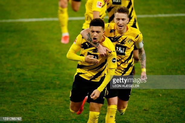 Dortmund's English midfielder Jadon Sancho and Dortmund's German forward Marco Reus celebrate the 0-1 during the German first division Bundesliga...