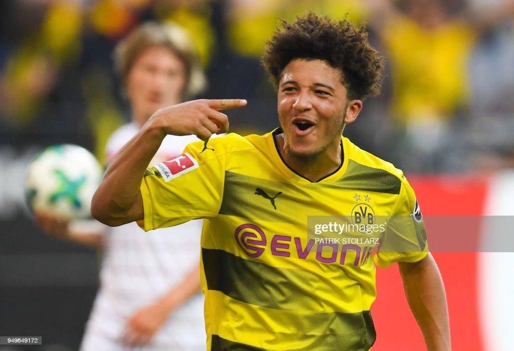 Dortmund's English midfielder Jadon Sancho celebrates after scoring during the German first division Bundesliga football match Borussia Dortmund vs Bayer Leverkusen, in Dortmund, western Germany, on April 21, 2018. (Photo by Patrik STOLLARZ / AFP)