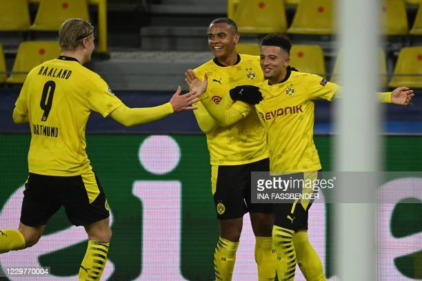 Dortmund's English midfielder Jadon Sancho celebrates scoring the 2-0 goal from a free kick with his teammates Dortmund's Swiss defender Manuel...