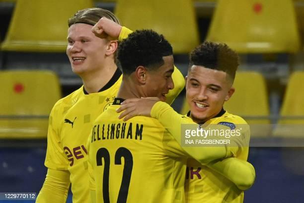 Dortmund's English midfielder Jadon Sancho celebrates scoring the 2-0 goal from a free kick with his teammates Dortmund's English midfielder Jude...