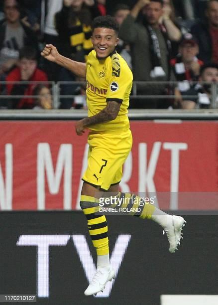 Dortmund's English midfielder Jadon Sancho celebrates scoring the 21 during the German first division Bundesliga football match Eintracht Frankfurt...