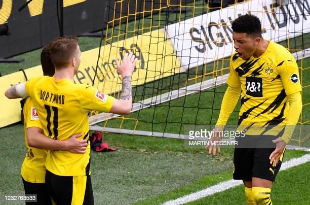 Dortmund's English midfielder Jadon Sancho celebrates with teammates scoring his side's third goal during the German first division Bundesliga...