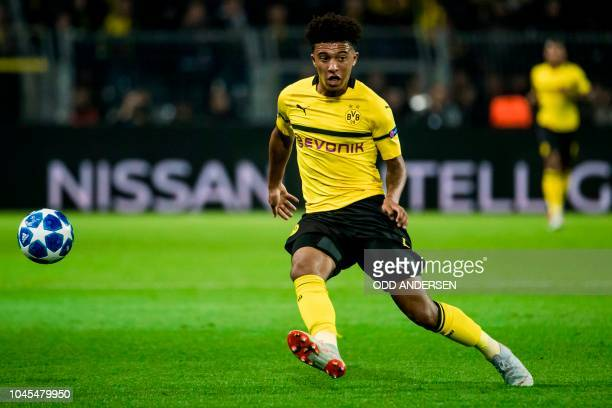 Dortmund's English midfielder Jadon Sancho chase the ball during the UEFA Champions League Group A football match BVB Borussia Dortmund v AS Monaco...
