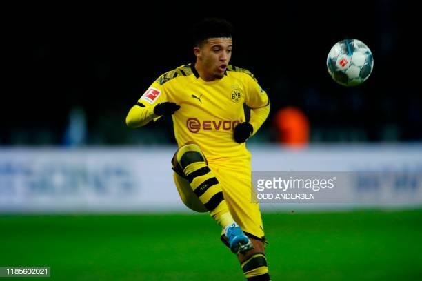Dortmund's English midfielder Jadon Sancho controls the ball during the German first division Bundesliga football match Hertha Berlin v Borussia...