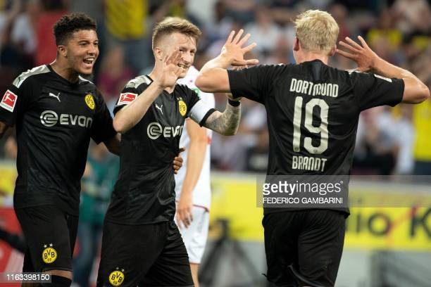 Dortmund's English midfielder Jadon Sancho Dortmund's German forward Marco Reusand Dortmund's German forward Julian Brandt celebrate the 12 goal...