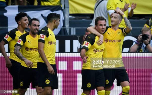 Dortmund's English midfielder Jadon Sancho Dortmund's Spanish forward Paco Alcacer Dortmund's Moroccan defender Achraf Hakimi Dortmund's German...