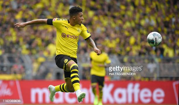 Dortmund's English midfielder Jadon Sancho jumps for a ball during the German first division Bundesliga football match BVB Borussia Dortmund v...