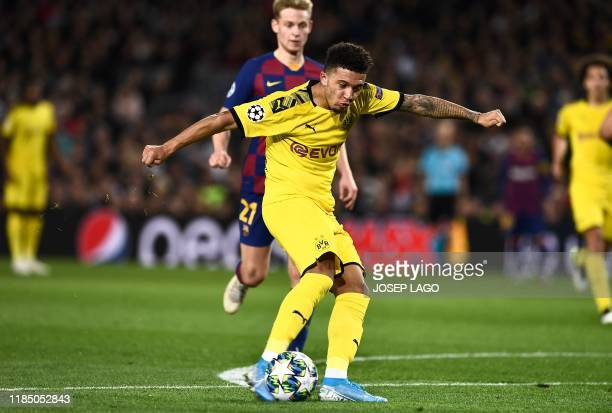 Dortmund's English midfielder Jadon Sancho kicks the ball to score during the UEFA Champions League Group F football match between FC Barcelona and...