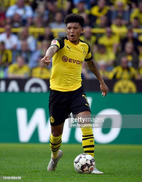 Dortmund's English midfielder Jadon Sancho plays the ball during the German first division Bundesliga football match Borussia Dortmund vs FC Augsburg...