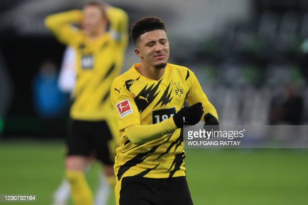 Dortmund's English midfielder Jadon Sancho reacts after he failed to score during the German first division Bundesliga football match Borussia...