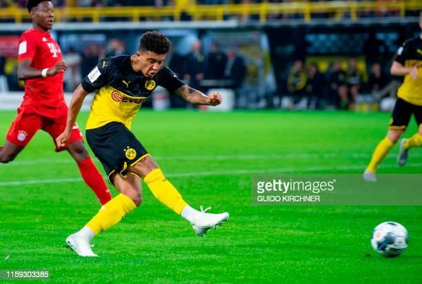 Dortmund's English midfielder Jadon Sancho scores the 20 goal during the German Supercup foorball match BVB Borussia Dortmund v FC Bayern Munich on...