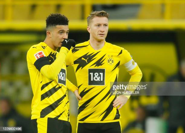 Dortmund's English midfielder Jadon Sancho stands next to Dortmund's German forward Marco Reus during the German first division Bundesliga football...
