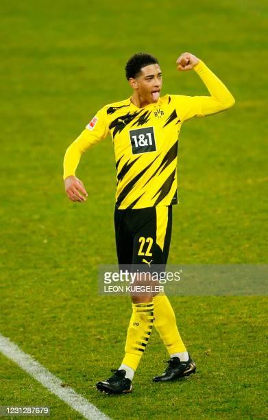 Dortmund's English midfielder Jude Bellingham celebrates after the German first division Bundesliga football match FC Schalke 04 vs Borussia Dortmund...