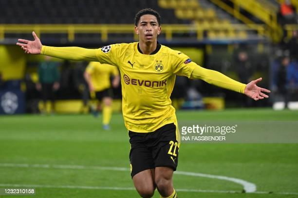 Dortmund's English midfielder Jude Bellingham celebrates scoring the opening goal during the UEFA Champions League quarter-final second leg football...