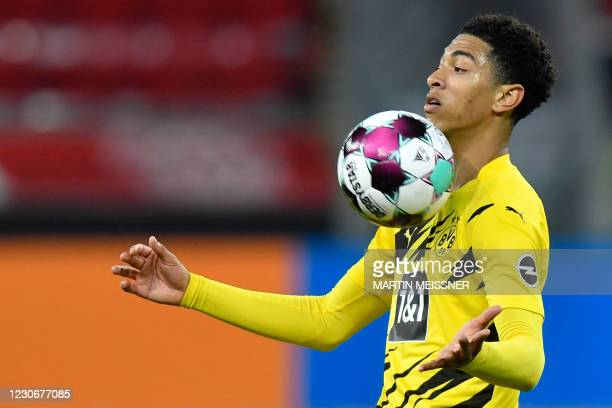 Dortmund's English midfielder Jude Bellingham controls the ball during the German first division Bundesliga football match Bayer 04 Leverkusen v BVB...