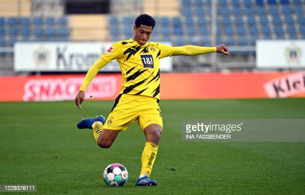 Dortmund's English midfielder Jude Bellingham plays the ball during the German first division Bundesliga football match between Arminia Bielefeld and...