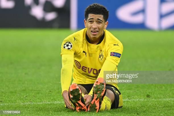 Dortmund's English midfielder Jude Bellingham sits on the pitch during the UEFA Champions League group F football match BVB Borussia Dortmund v Lazio...