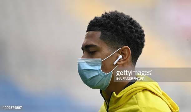Dortmund's English midfielder Jude Bellingham wears a face mask before the German first division Bundesliga football match between Arminia Bielefeld...