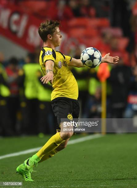 Dortmund's Erik Durm controls the ball during the first leg of the Champions League quarter final knockout match between the Portuguese champions...