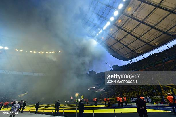 Dortmund's fans light flares during the German Cup final football match Bayern Munich vs Borussia Dortmund at the Olympic stadium in Berlin on May 21...