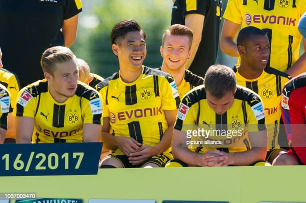 Dortmund's Felix Passlack Shinji Kagawa Marco Reus Mario Goetze and Adrian Ramos posing for a group photo for the season 2016/2017 in Dortmund...
