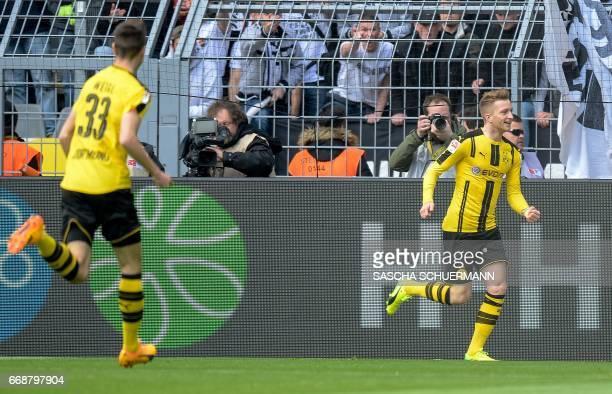 Dortmund's forward Marco Reus celebrates scoring during the German First division Bundesliga football match between Borussia Dortmund and Eintracht...