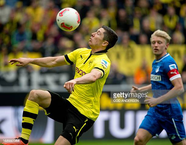 Dortmund's forward Robert Lewandowski of Poland and Hoffenheim's Andreas Beck vie for the ball during the German first division Bundesliga football...