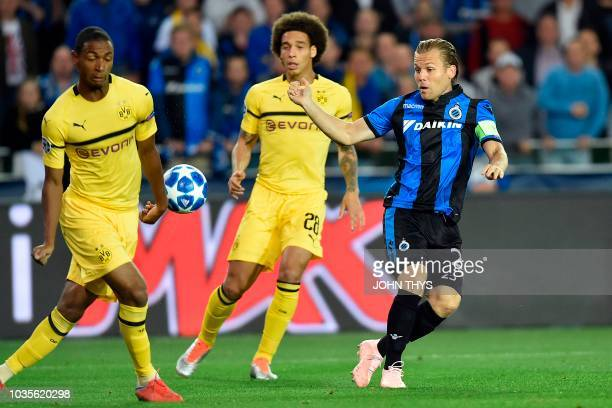 Dortmund's French defender Abdou Diallo vies with Club Brugge's Dutch midfielder Ruud Vormer past Dortmund's Belgian midfielder Axel Witsel during...