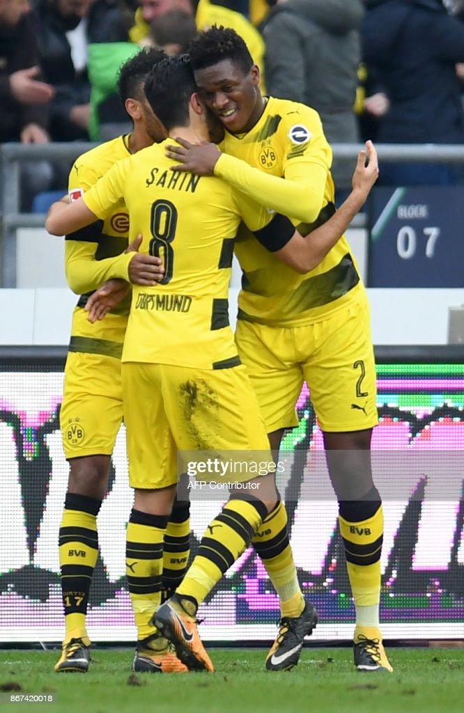 Dortmund's French defender Dan-Axel Zagadou and his teammates celebate after scoring during the German First division Bundesliga football match Hanover 96 vs Borussia Dortmund in Hanover, Germany, on October 28, 2017. /