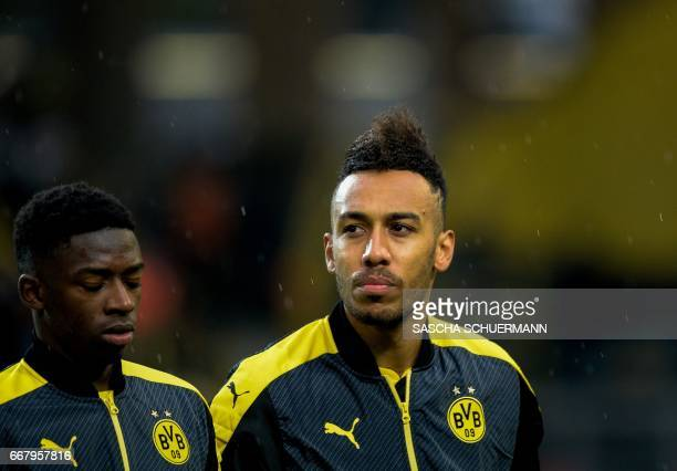 Dortmund's French midfielder Ousmane Dembele and Dortmund's Gabonese forward PierreEmerick Aubameyang are pictured prior to the UEFA Champions League...