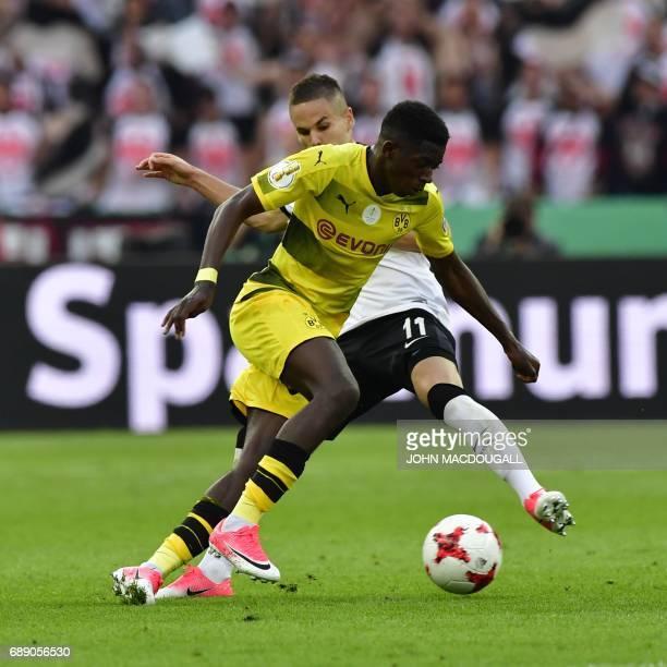 Dortmund's French midfielder Ousmane Dembele and Frankfurt's Serbian midfielder Mijat Gacinovic vie for the ball during the German Cup final football...