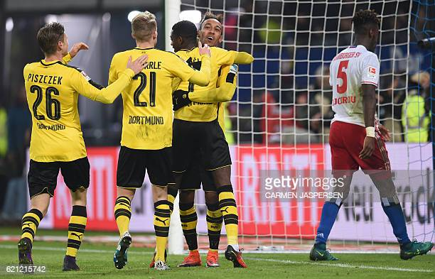 Dortmund's French midfielder Ousmane Dembele celebrates scoring with Dortmund's Gabonese forward PierreEmerick Aubameyang Dortmund's Polish defender...