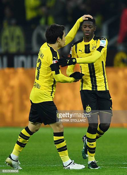 Dortmund's French midfielder Ousmane Dembele celebrates scoring with Dortmund's Japanese midfielder Shinji Kagawa during the German First division...