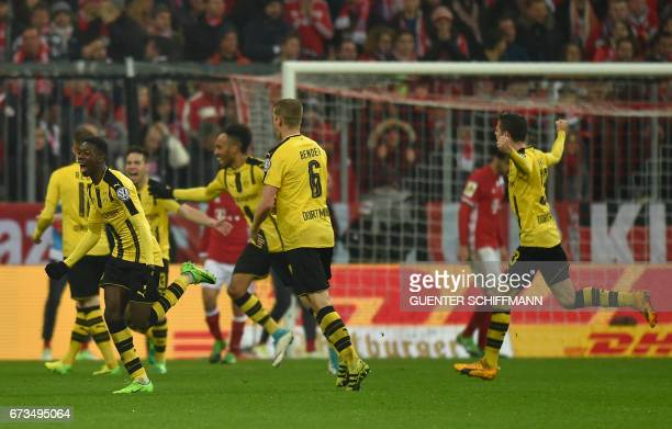Dortmund's French midfielder Ousmane Dembele celebrates with teammates after the second goal for Dortmund during the German Cup DFB Pokal semifinal...