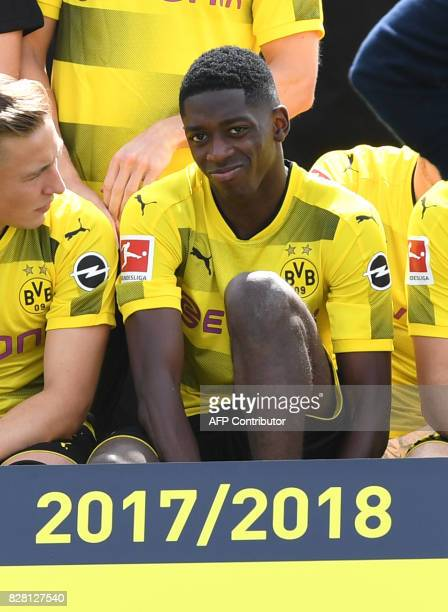 Dortmund's French midfielder Ousmane Dembele smiles as he has taken seat for the team photo during a press event of German first division Bundesliga...