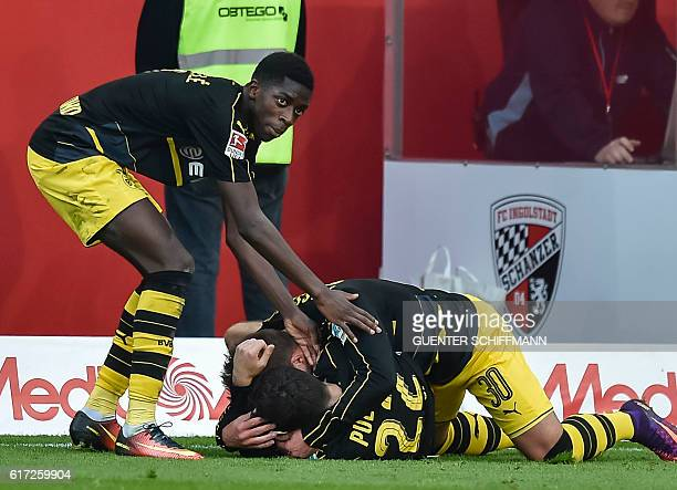Dortmund's French striker Ousmane Dembele Dortmund's German defender Felix Passlack and Dortmund's American midfielder Christian Pulisic celebrate...