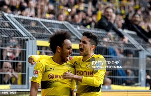 TOPSHOT Dortmund's Gabonese forward PierreEmerick Aubameyang and Dortmund's Spanish defender Marc Bartra celebrate the 43 during the German first...