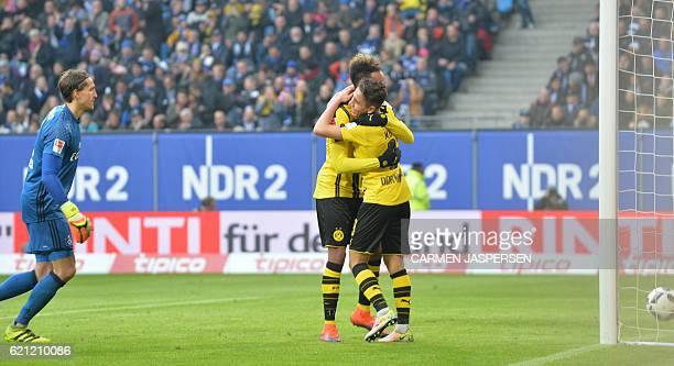 Dortmund's Gabonese forward PierreEmerick Aubameyang celebrate scoring with Dortmund's Turkish midfielder Emre Mor during the German first division...