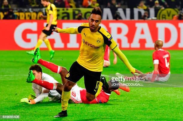 Dortmund's Gabonese forward PierreEmerick Aubameyang celebrate scoring a hattrick the 40 goal during the UEFA Champions League Round of 16 2ndleg...