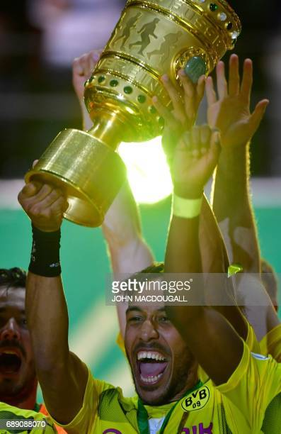 Dortmund's Gabonese forward PierreEmerick Aubameyang celebrate with the trophy after victory in the German Cup final football match Eintracht...