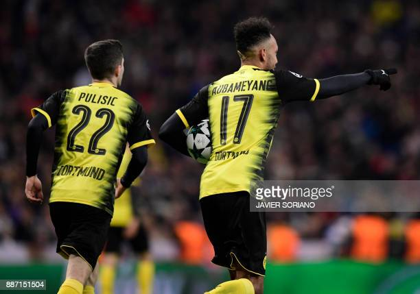 Dortmund's Gabonese forward PierreEmerick Aubameyang celebrates a goal during the UEFA Champions League group H football match Real Madrid CF vs...