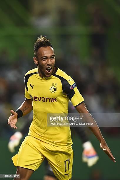 Dortmund's Gabonese forward PierreEmerick Aubameyang celebrates after scoring during the UEFA Champions League football match Sporting CP vs BVB...