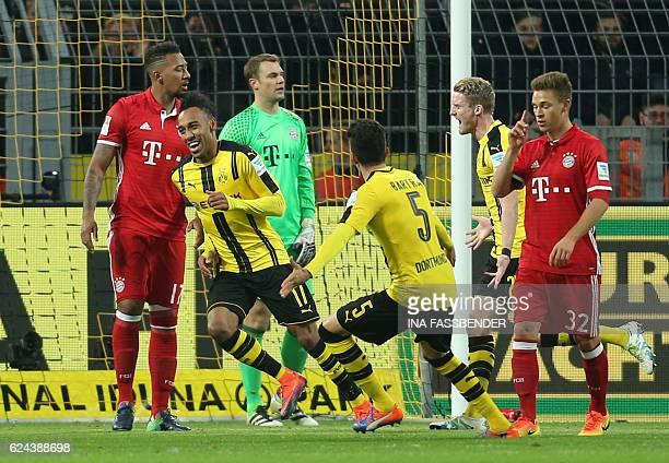 Dortmund's Gabonese forward PierreEmerick Aubameyang celebrates after scoring the opening goal during the German first division Bundesliga football...