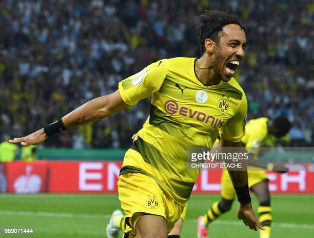 Dortmund's Gabonese forward PierreEmerick Aubameyang celebrates after scoring a penalty goal during the German Cup final football match Eintracht...