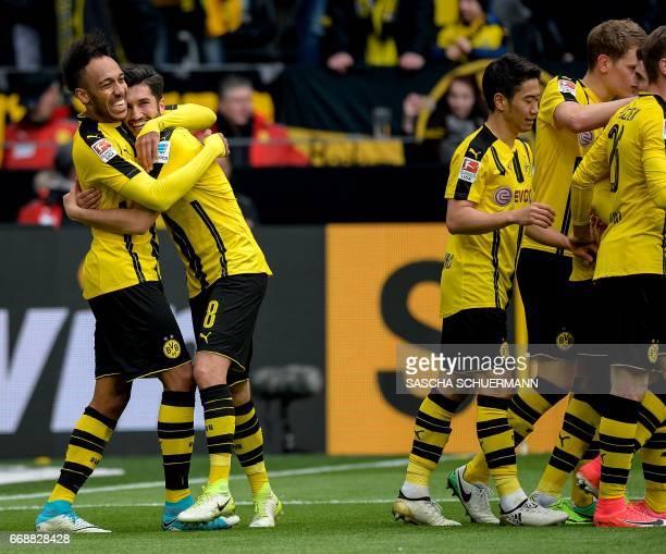 Dortmund's Gabonese forward PierreEmerick Aubameyang celebrates his 31 goal during the German First division Bundesliga football match between...