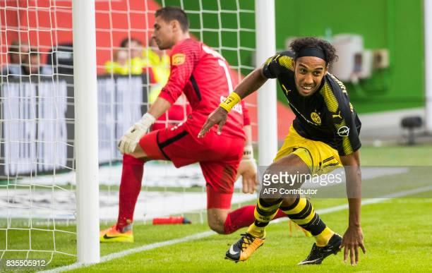 Dortmund's Gabonese forward PierreEmerick Aubameyang celebrates scoring his side's third goal past Wolfsburg's Belgian goalkeeper Koen Casteels...