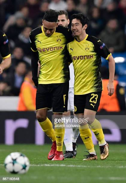 Dortmund's Gabonese forward PierreEmerick Aubameyang celebrates his second goal with Dortmund's Japanese midfielder Shinji Kagawa during the UEFA...