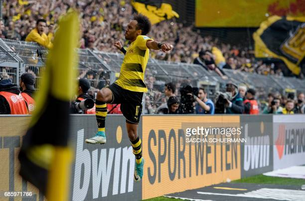 Dortmund's Gabonese forward PierreEmerick Aubameyang celebrates the 43 during the German first division football match between Borussia Dortmund and...
